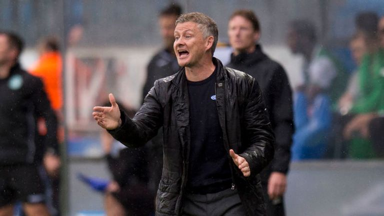 Molde manager Ole Gunnar Solskjaer gestures during the game