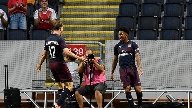 Reiss Nelson celebrates after scoring against Lazio