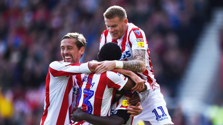 Crouch (left) is looking to help Stoke return to the Premier League at the first time of asking