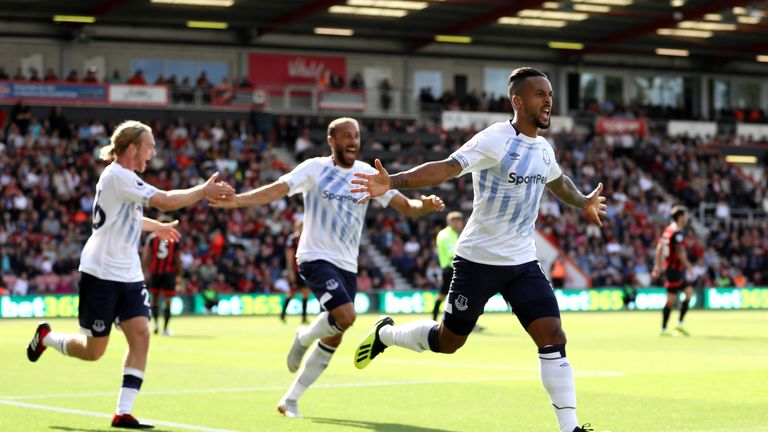 Theo Walcott celebrates after scoring the opening goal of the game