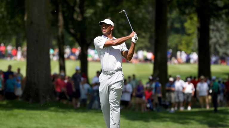 Tiger Woods made only one birdie as he slid 11 shots behind