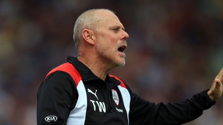 Former Barnsley assistant Tommy Wright has been charged with two counts of accepting a bribe