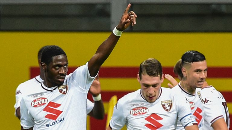Ola Aina (L) celebrates Torino's equaliser