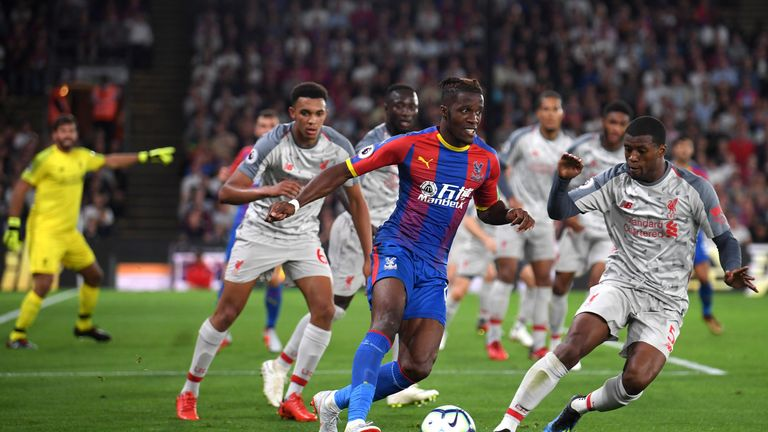 Wilfried Zaha tries to get away from defenders at Selhurst Park