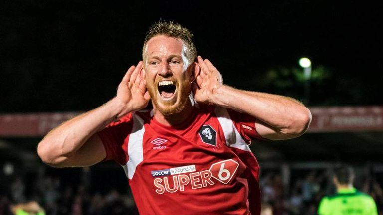 Adam Rooney celebrates his double against Halifax