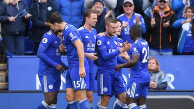 Jamie Vardy is congratulated by team-mates after scoring Leicester City's third goal