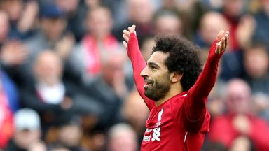Mohamed Salah celebrates after scoring Liverpool's third goal