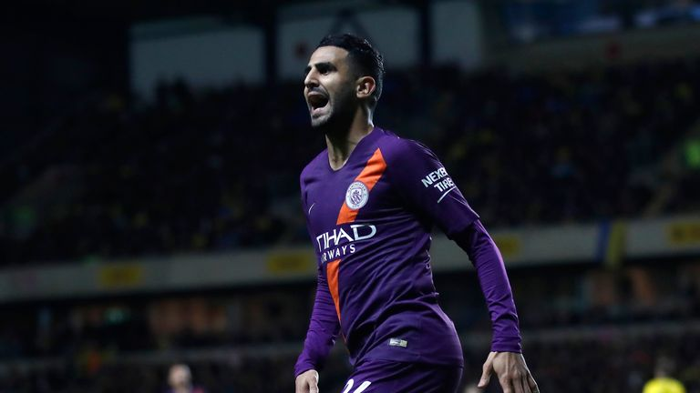 Riyad Mahrez celebrates after putting Man City 2-0 up