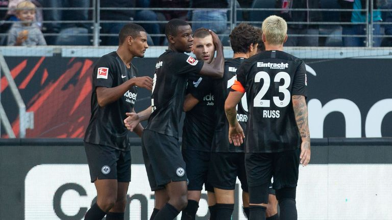 Ante Rebic celebrates with his team-mates after scoring against Hannover 96