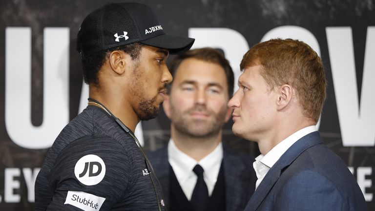 Britain's Anthony Joshua (L) poses by his challenger Russia's Alexander Povetkin during a joint press conference at Wembley stadium in London on September 20, 2018 ahead of the title defence boxing match on Saturday
