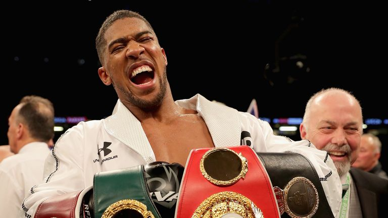 Anthony Joshua celebrates his points victory over Joseph Parker at the Principality Stadium on March 31, 2018