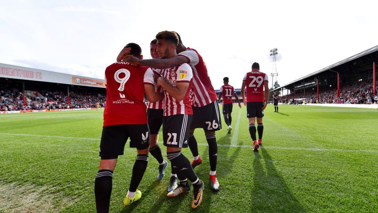 Neal Maupay scored twice as Brentford went up to second