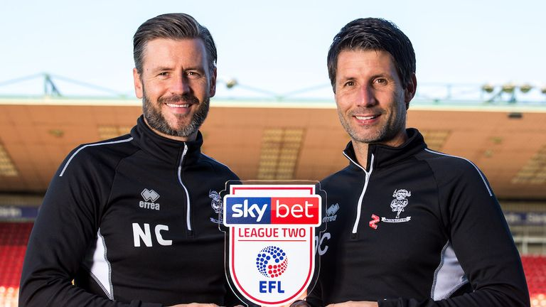 Danny Cowley poses with brother Nicky after winning the League Two Manager of the Month award earlier this season