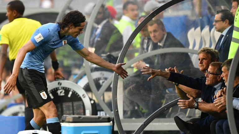 Edinson Cavani celebrates with Tabarez