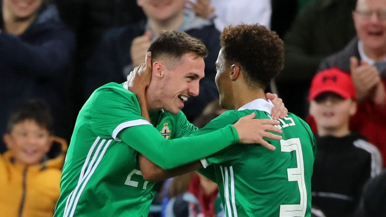Northern Ireland's Gavin Whyte (left) celebrates scoring his side's third goal