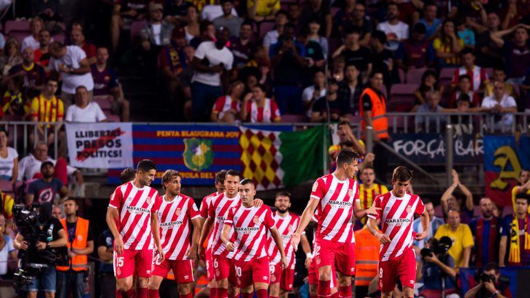 Girona celebrate after Christian Stuani's goal put them 2-1 up at the Nou Camp