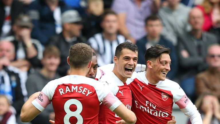 Granit Xhaka celebrates scoring against Newcastle