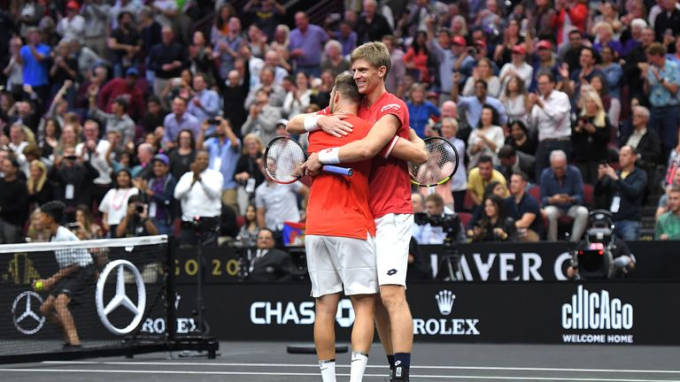 Sock and Anderson celebrate putting a point on the board for Team World