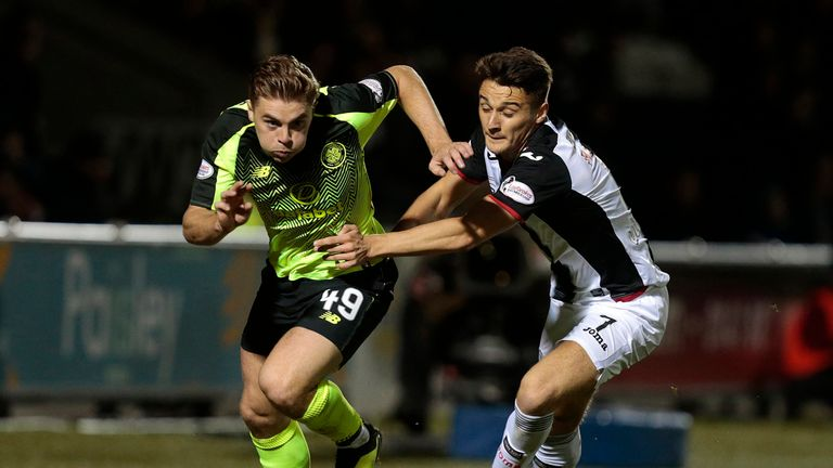 St Mirren's Kyle Magennis (right) and Celtic's James Forrest battle for the ball