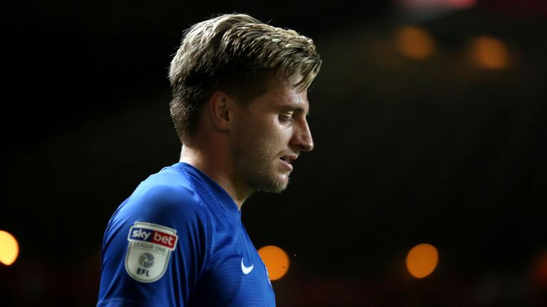 Peterborough say they will support striker Jason Cummings