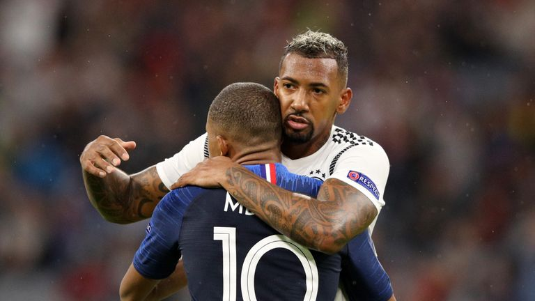 Jerome Boateng hugs PSG and France's Kylian Mbappe during last week's friendly