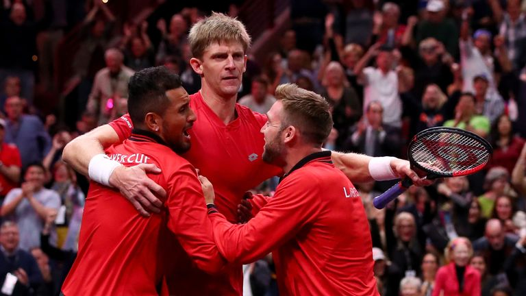 Team World Kevin Anderson of South Africa celebrates with teammates Team World Nick Kyrgios of Australia and Team World Jack Sock of the United States after defeating Team Europe Novak Djokovic of Serbia in his Men's Singles match on day two of the 2018 Laver Cup at the United Center on September 22, 2018 in Chicago,