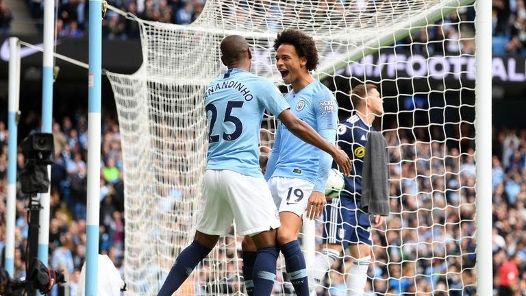 Leroy Sane celebrates scoring Manchester City's first goal against Fulham