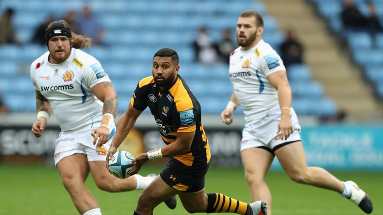 Lima Sopoaga of Wasps off loads the ball