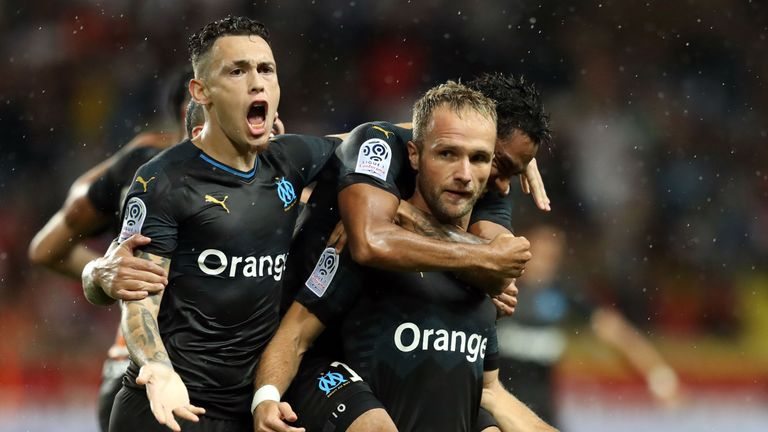 Valere Germain (right) celebrates his winner for Marseille