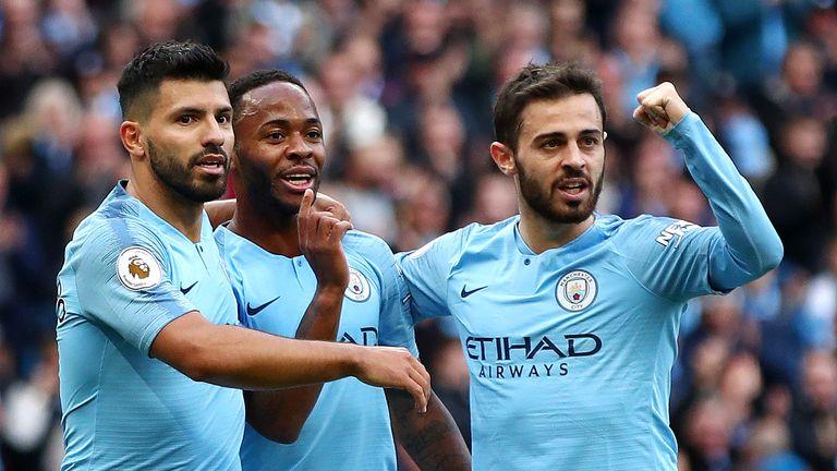 Bernardo Silva (right) celebrates City's opener against Brighton with Aguero and goalscorer Raheem Sterling