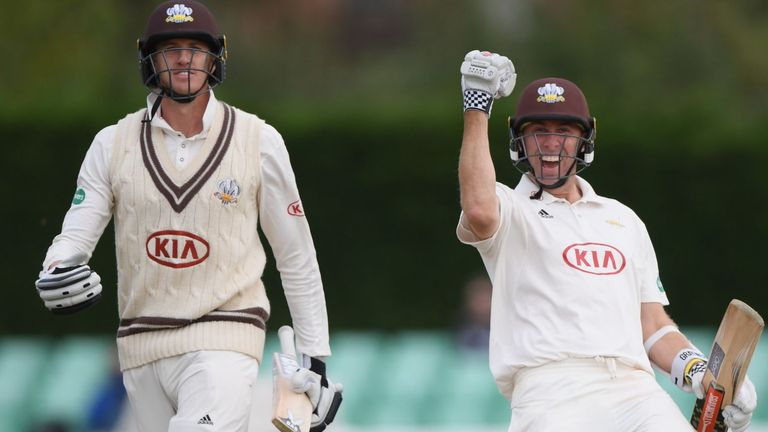 Clarke celebrates Surrey's first County Championship title since 2002