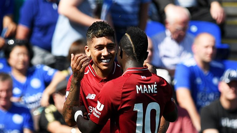 Firmino celebrates with Mane after doubling Liverpool's lead