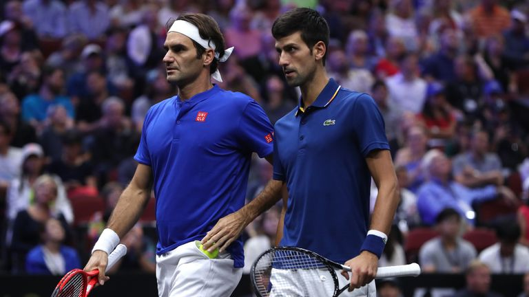 Team Europe Roger Federer of Switzerland and Team Europe Novak Djokovic of Serbia react against Team World Jack Sock of the United States and Team World Kevin Anderson of South Africa during their Men's Doubles match on day one of the 2018 Laver Cup at the United Center on September 21, 2018 in Chicago, Illinois.