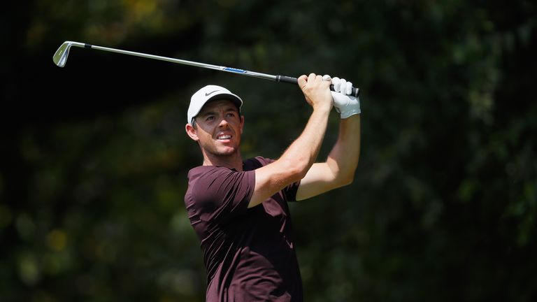 Tiger Woods, Justin Rose share lead at Tour Championship
