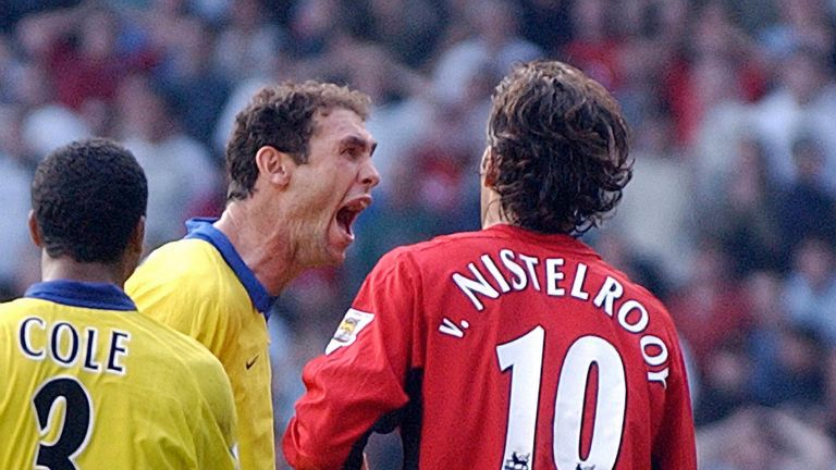 Martin Keown taunts Ruud van Nistelrooy following his penalty miss in 2003