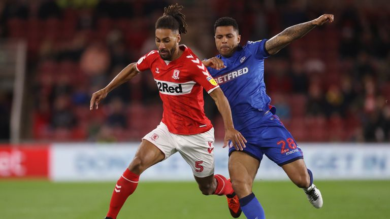 Middlesbrough's Ryan Shotton (left) and Bolton Wanderers' Josh Magennis battle for the ball during the Sky Bet Championship match at the Riverside Stadium, Middlesbrough.