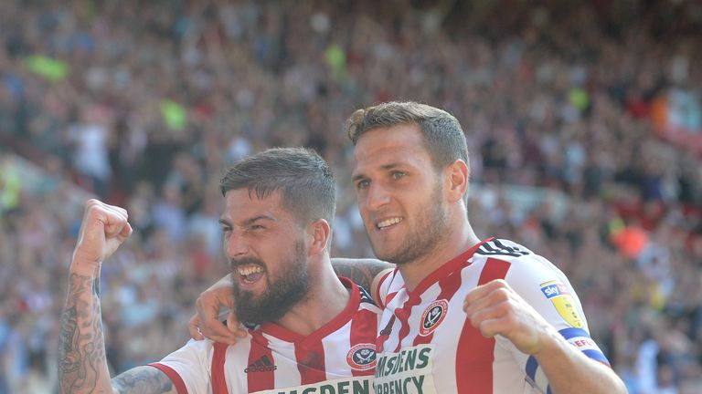 Sheffield United's Billy Sharp (right) celebrates scoring his side's fourth goal of the game