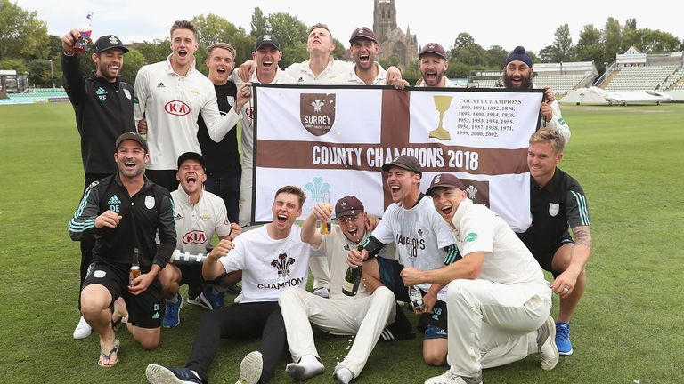 Surrey celebrate on the pitch after sealing the County Championship title
