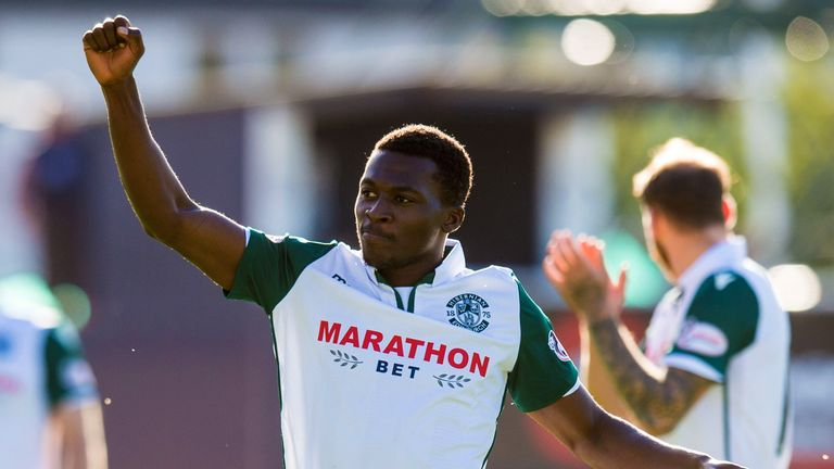 Hibs' Thomas Agyepong celebrates at full-time