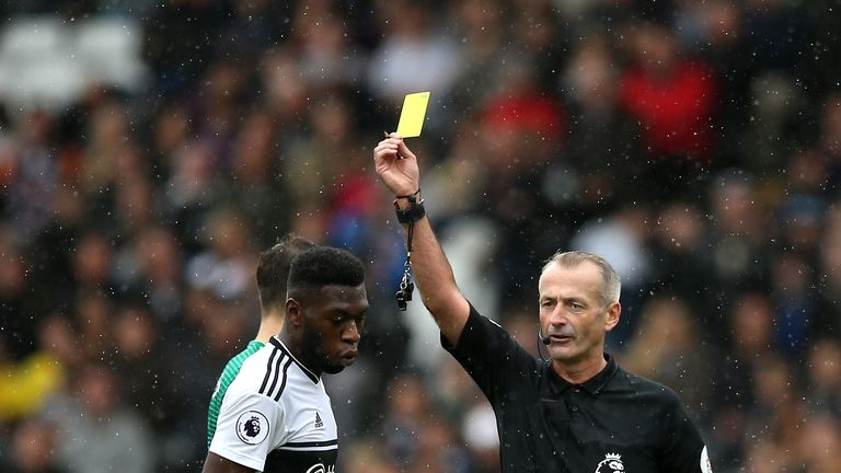 Timothy Fosu-Mensah is shown a yellow card by Martin Atkinson, but should it have been a red?