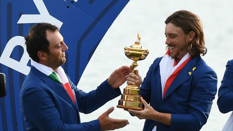 Tommy Fleetwood and Francesco Molinari get their hands on the Ryder Cup trophy
