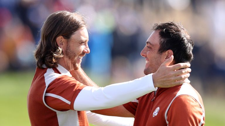 Team Europe's Tommy Fleetwood and Team Europe's Francesco Molinari celebrate winning their round