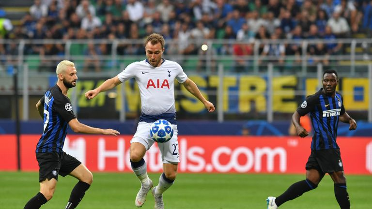 Christian Eriksen controls the ball under pressure from Marcelo Brozovic