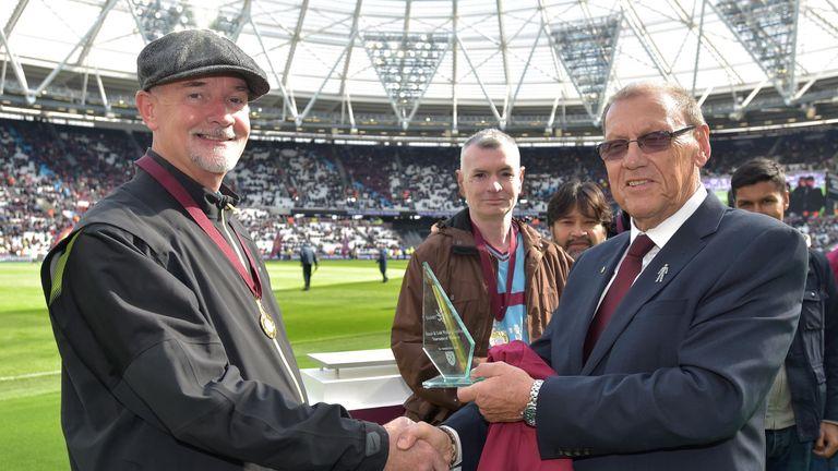 Former West Ham striker Brian Dear presents the trophy