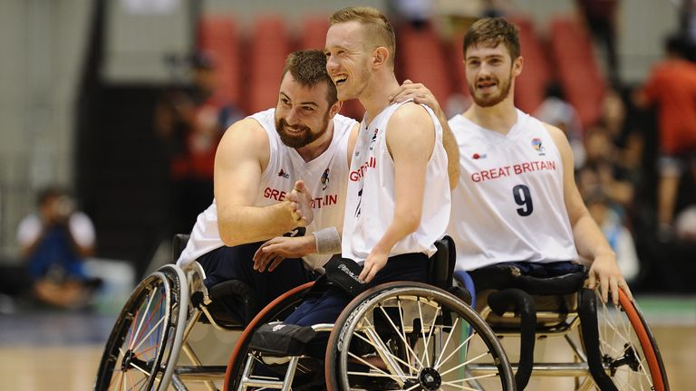Simon Brown, Gregg Warburton and Harrison Brown of Great Britain celebrate victory during the Wheelchair Basketball World Challenge Cup match between Great Britain and Japan at the Tokyo Metropolitan Gymnasium on September 1, 2017 in Tokyo, Japan