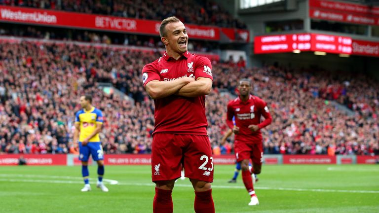 Xherdan Shaqiri of Liverpool celebrates after he provides the assist for Liverpool's first goal