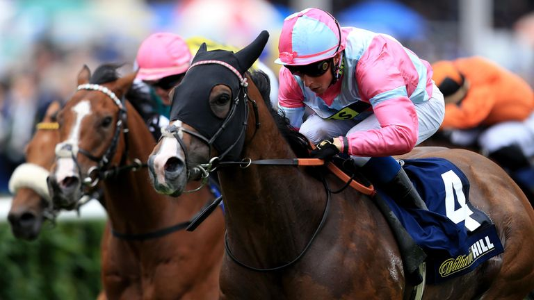 A Momentofmadness ridden by jockey William Buick wins the William Hill Portland Handicap