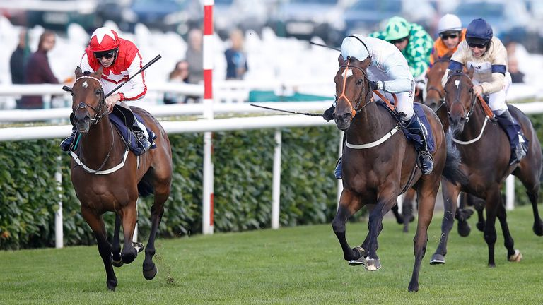 Central City (left) ridden by Ted Durcan wins the Clipper Logistics Leger Legends Classified Stakes