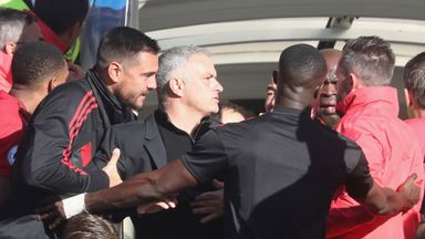Jose Mourinho is held back after reacting after a fiery finish at Stamford Bridge