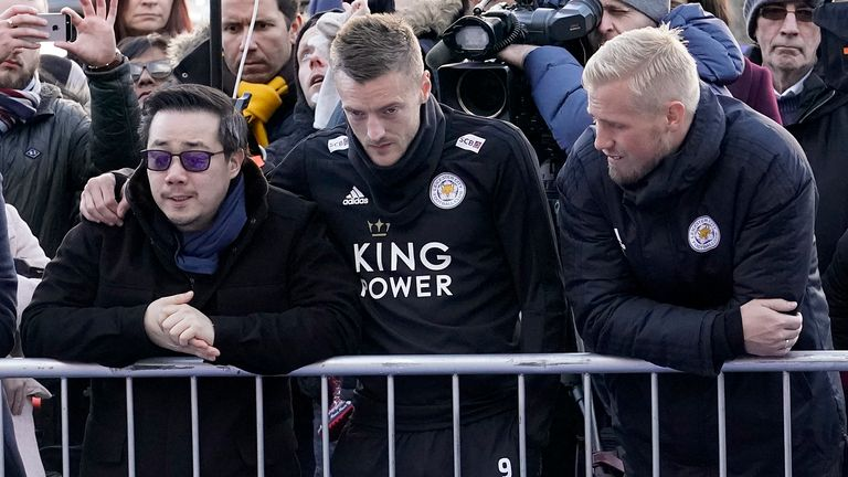 Jamie Vardy and Kasper Schmeichel accompany Srivaddhanaprabha's son Aiyawatt at the memorial to his father outside the King Power Stadium